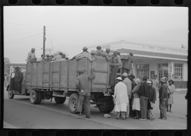Cotton pickers boarding truck which will take them to the fields, Pine Bluff, Arkansas