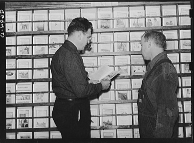 County supervisor and rehabilitation client in the Farm Security Administration office. Yates Center, Kansas