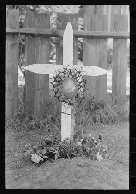 Decorated gravemarker on All Saints' Day, New Roads, Louisiana. Note the beaded ornament, which is made of wire and beads