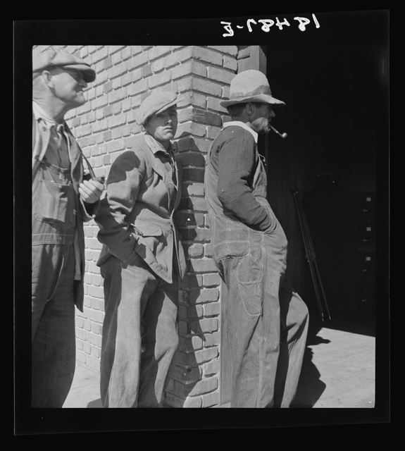 Destitute farm families come to FSA (Farm Security Administration) distributing depot to apply for food grant. Bakersfield, Kern County, California