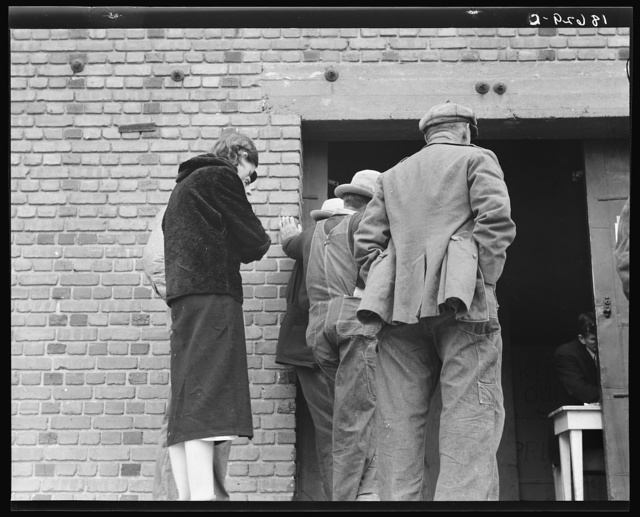 Destitute farm labor families come to Farm Security Administration (FSA) distributing depot to apply for food grant. Kern County, California