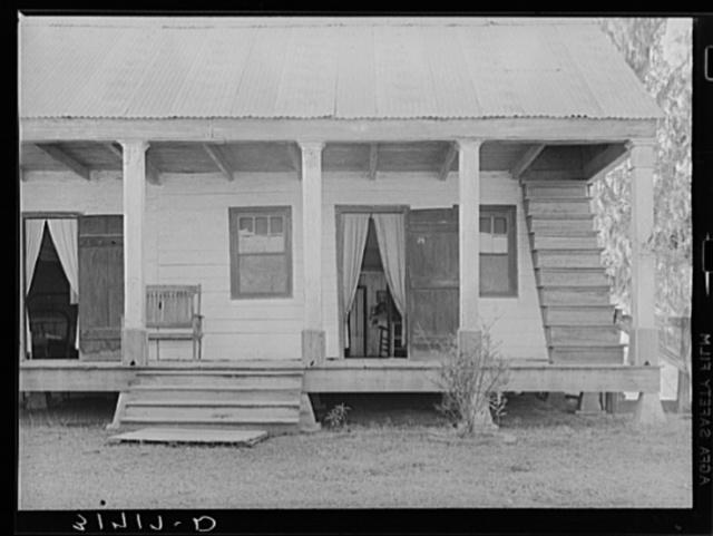 Detail of house with outside stairway to attic. Near Breaux Bridge, Louisiana