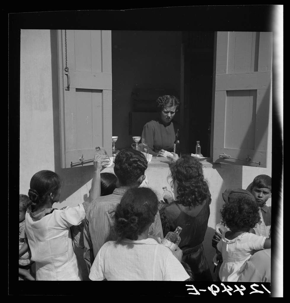 Distribution of free medicine outside a P.R.R.A. (Puerto Rico Resettlement Administration) health center. San Juan, Puerto Rico