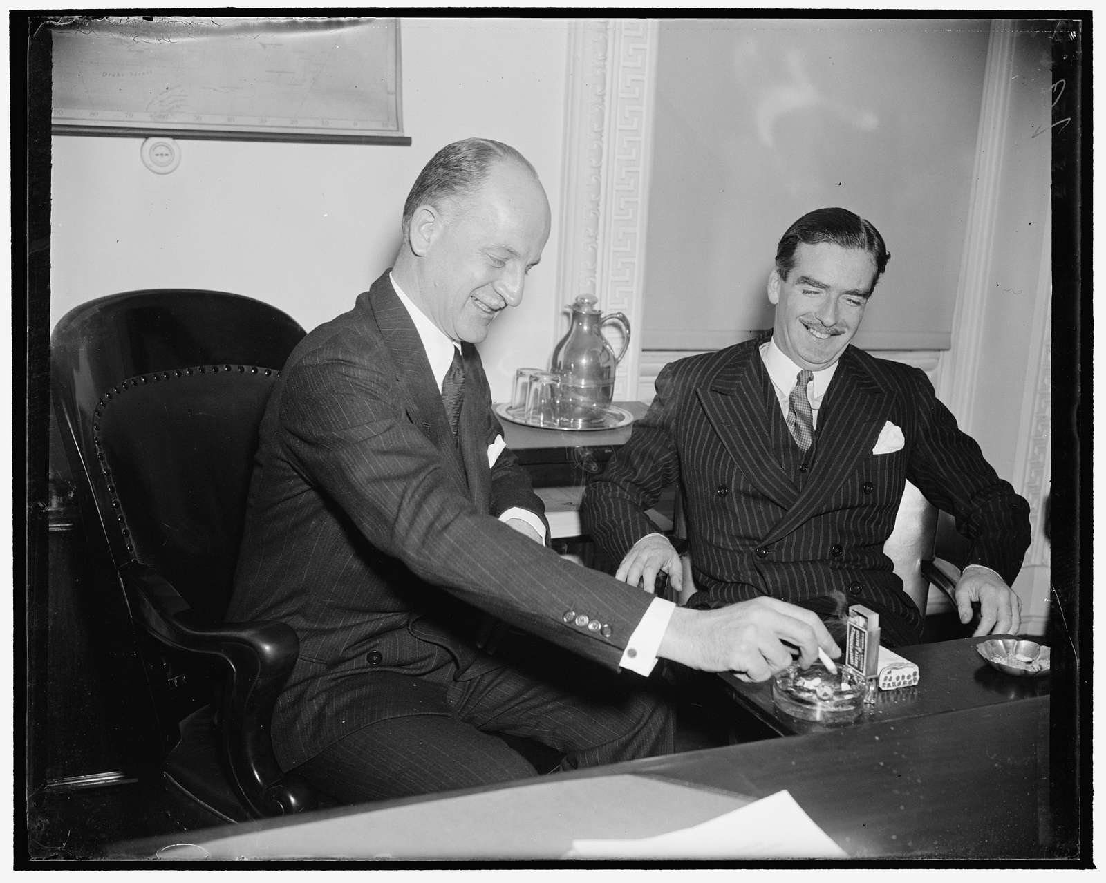 Eden calls on acting Secretary of State. Washington, D.C., Dec. 13. Anthony Eden, former British Foreign Secretary, was in rare humor as he called on acting Secretary of State Sumner Welles today at the State Department. Later Secretary Welles accompanied Eden to the White House where he paid his respects to President Roosevelt, 121338