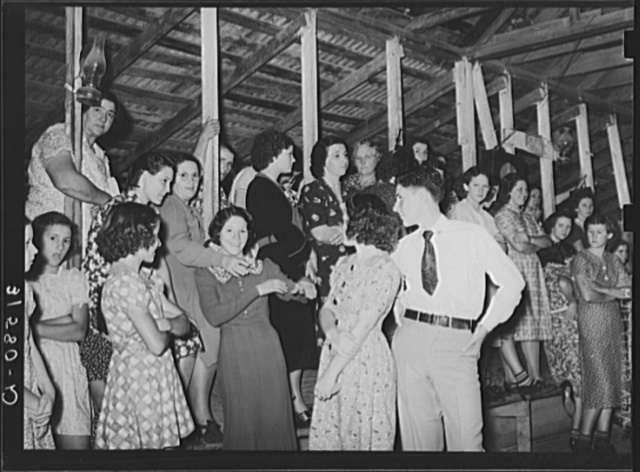 Fais-do-do near Crowley, Louisiana. These are gatherings of local country people usually of French origin who are clannish. Very few outsiders are present at these dances. Sections of the hall are reserved for the different sexes. They are usually attended by family groups, the smaller children and babies sleeping in their mother's arms and on a huge bed with a rice straw mattress