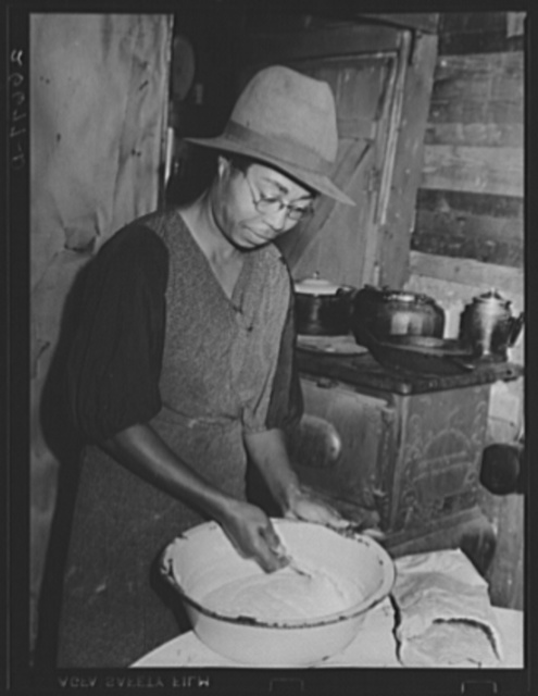 "Farm laborer's wife preparing meal. ""Eighty Acres,"" Glassboro, New Jersey"
