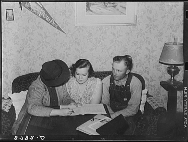 Farm Security Administration home supervisor examining account book of rehabilitation clients. Otoe County, Nebraska