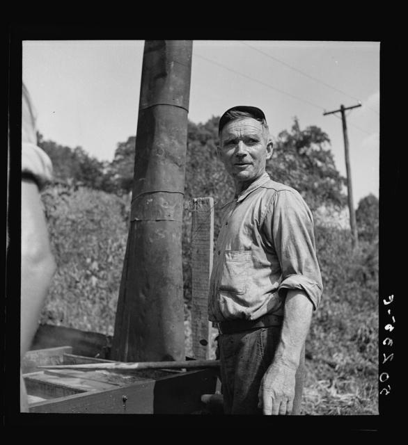 Farmer making molasses from sugarcane. Racine, West Virginia