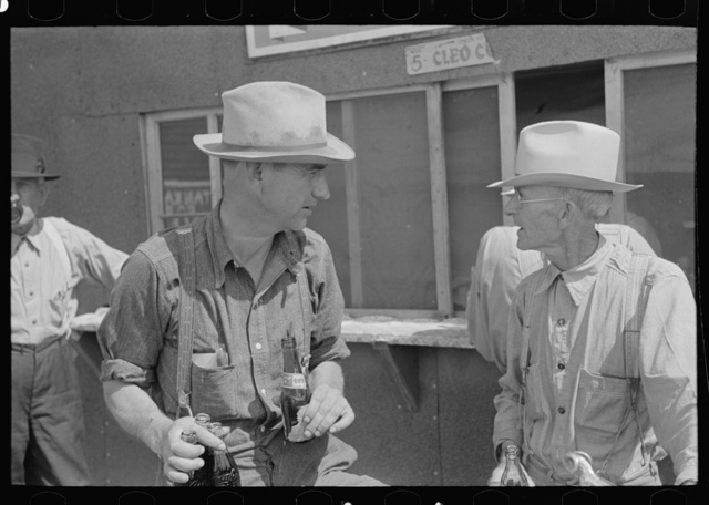 Farmers at auction with soft drinks, Sikeston, Missouri