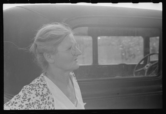 Farmer's wife watching proceedings at farm auction, New Carlisle, Ohio