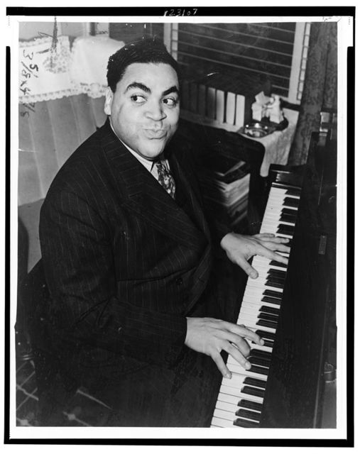 [Fats Waller, three-quarter length portrait, seated at piano, facing front] / World Telegram & Sun photo by Alan Fisher.