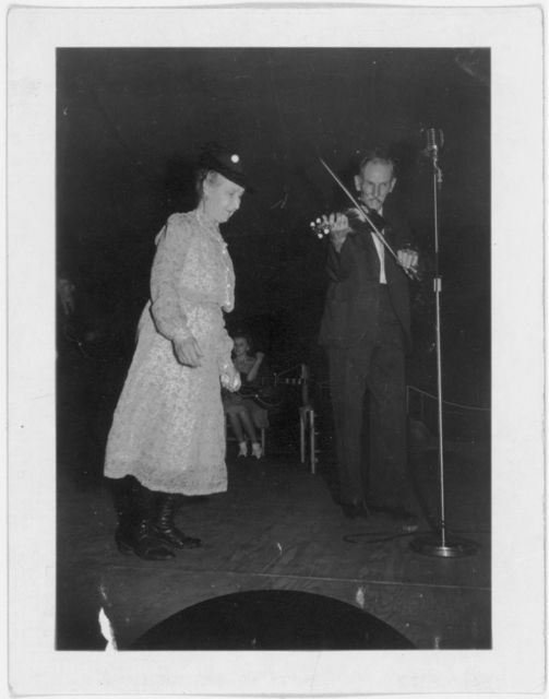 [Fiddling Bill Hensley, playing fiddle and unidentified woman, at the Mountain Music Festival, Asheville, North Carolina]