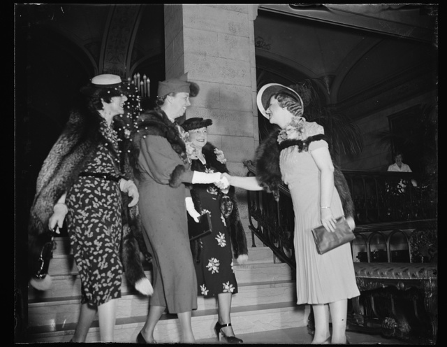 FIRST LADY GUEST OF 73 CLUB. WASHINGTON, D.C. APRIL 5. MRS. FRANKLIN ROOSEVELT IS GREETED BY MRS. RICHARD M. DUNCAN, WIFE OF THE CONGRESSMAN FROM MISSOURI, AS SHE ARRIVES AT THE SHOREHAM HOTEL TODAY TO BE A GUEST OF THE 73 CLUB AT A LUNCHEON. WIVES OF SENATORS AND REPRESENTATIVES WHO ENTERED CONGRESS IN THE 73RD SESSION FORM THE MEMBERSHIP OF THE CLUB. L TO R: MRS. ERNEST LUNDEEN, WIFE OF SENATOR FROM MINNESOTA; MRS. ROOSEVELT; MRS. FRED BIERMAN, WIFE OF REP. FROM IOWA; AND MRS. DUNCAN, PRESIDENT OF THE CLUB
