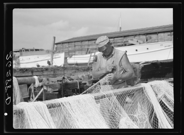 Fisherman mending his net. Key West, Florida