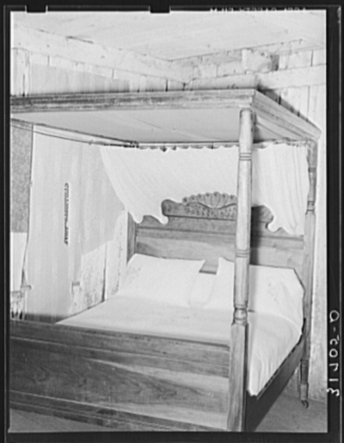Four-poster bed with canopy and mosquito bar in home near Lutcher, Louisiana