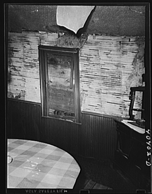 Gilberton, Pennsylvania. Interior of Marcella Urban's house, showing walls from which the plaster has fallen