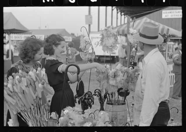 Girl buying cane from concessionaire, Donaldsonville, Louisiana, state fair