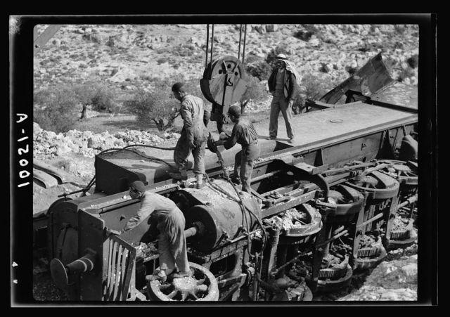G.O.C. visits overturned locomotive on the Jerusalem Lydda Railroad Line. Cables being adjusted to raise derelict
