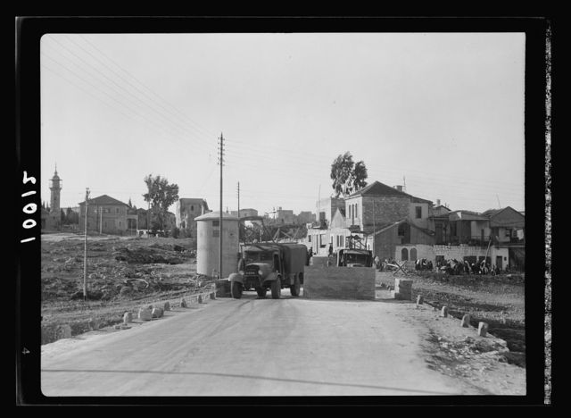 Government defense measures on highway leading into Jerusalem from the north, Nablus Road. Lorries threading their way through concrete blocks