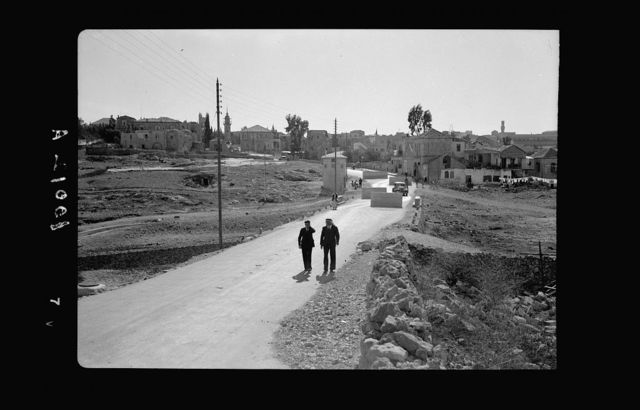 Government defense measures on highway leading into Jerusalem from the north, Nablus Road. Car threading its way through concrete blocks