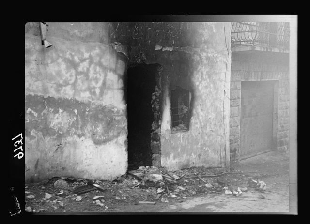 Haifa, result of terrorist acts & government measures. H.M.S. Incendiary in a Jewish Quarter in Haifa, gutted doorway