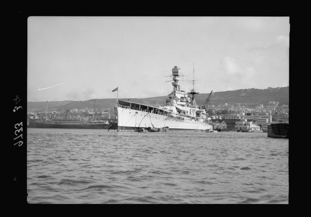 Haifa, result of terrorist acts & government measures. H.M.S. Repulse with Haifa in background