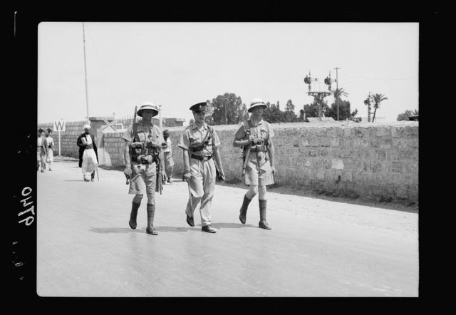 Haifa, result of terrorist acts & government measures. H.M.S. Two marines with one British Police patrolling Nazareth Str[eet] in Ha[ifa]