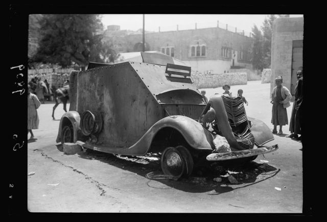 Hebron attack, August, 19, 1938. Closer view of armoured car wrecked & burned close to Barclay's Bank, driver killed