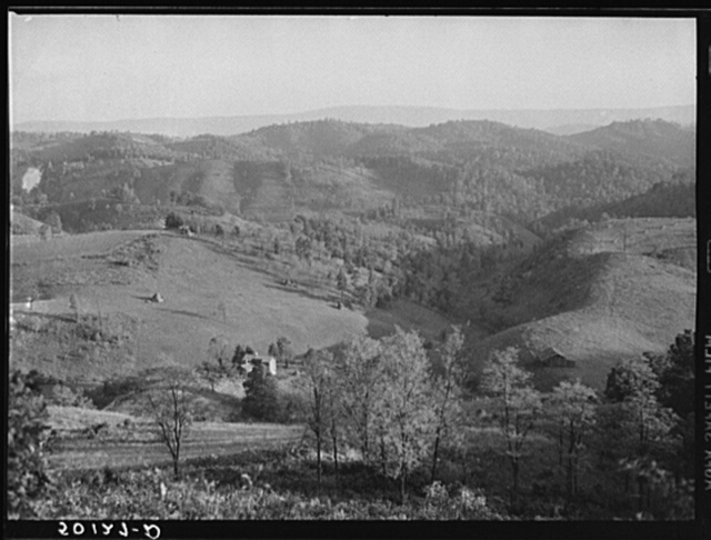 Hilly country with an occasional small farm in coal mining section of southern West Virginia