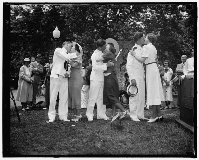 Honor students receive awards. Annapolis, Md. June 3. The three midshipmen who places highest in competitive examinations, receive another award after getting their diplomas, left to right; Jack Obermeyer, of New York, gets a kiss from Mary M. Scott of South Orange, N.J., Honor Man #2, Russell H. Wallace, of Westbridgewater, Penna. gets his from Harriet Engle, of Pittsburgh, Penna, and Honor Man #3 Emery A. Grantham, of Albany Texas, gets a kiss from Christine Gawne, of Washington, D.C.