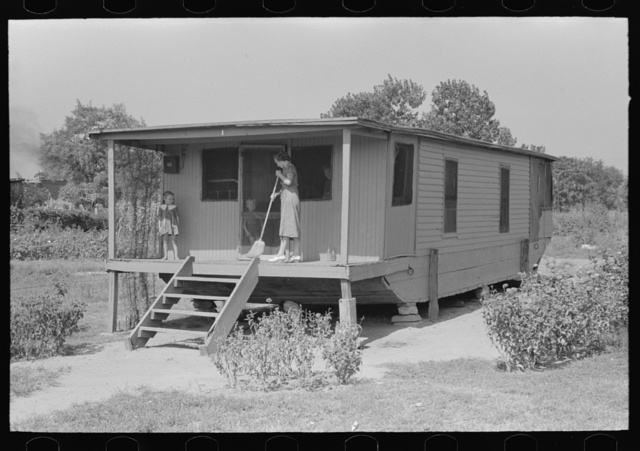 House on river side of levee near Caruthersville, Missouri. Note this is adaptation of house boat
