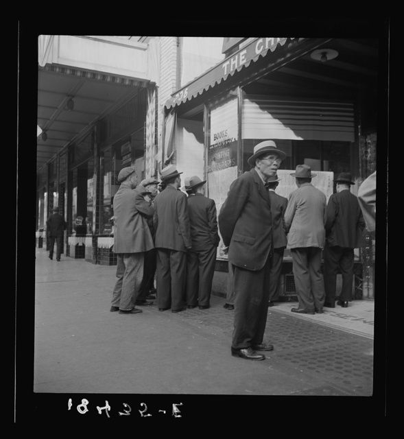 In front of the local paper of San Francisco's Chinatown Chinese read news of the surrender of Canton to the Japanese. Most of San Francisco's Chinese are Cantonese