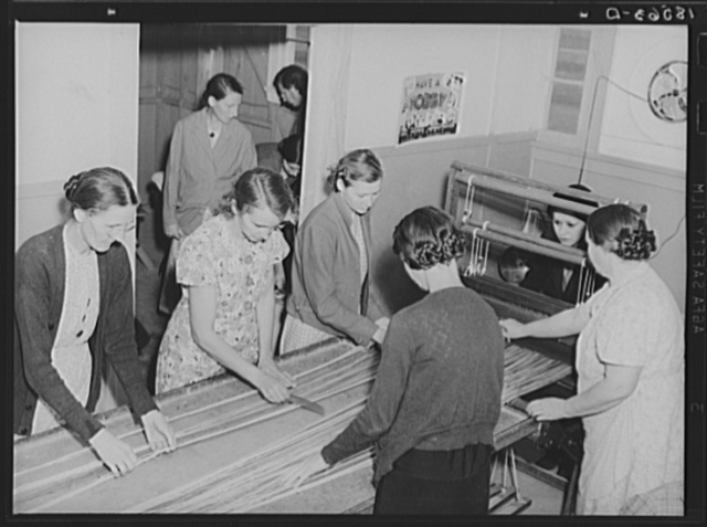 In the sewing room, migrant women are instructed in rug-making. Shafter camp for migrants (Farm Security Administration-FSA), California. Recreational, educational, cooperative activities in the camp are aided by Work Projects Administration instructors assigned to the camp programs