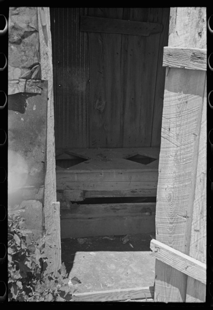 Interior of sharecropper privy, New Madrid County, Missouri
