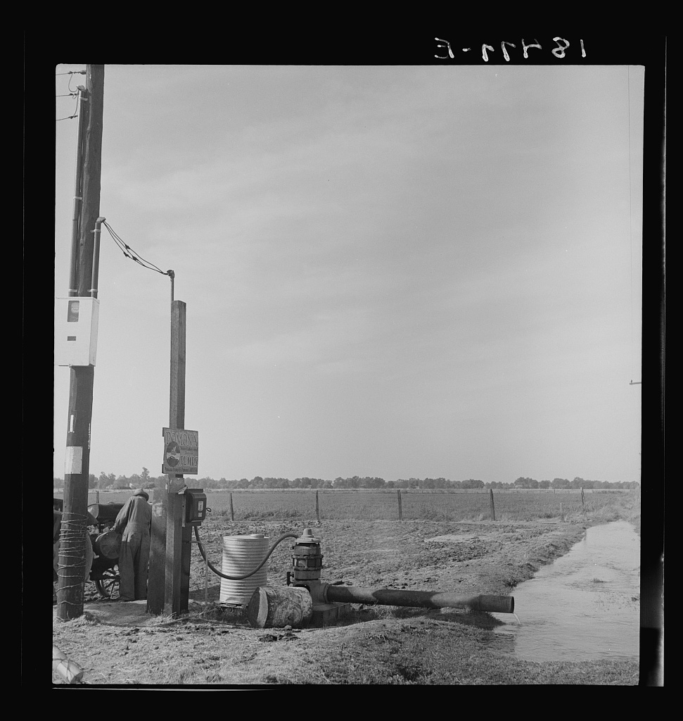 Irrigation pump on edge of field. Electric power typical of San Joaquin Valley farming. California