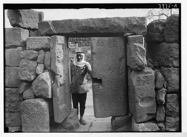 Jebel el-Druze & Hauran. Kanawat. Double stone (basalt) doors