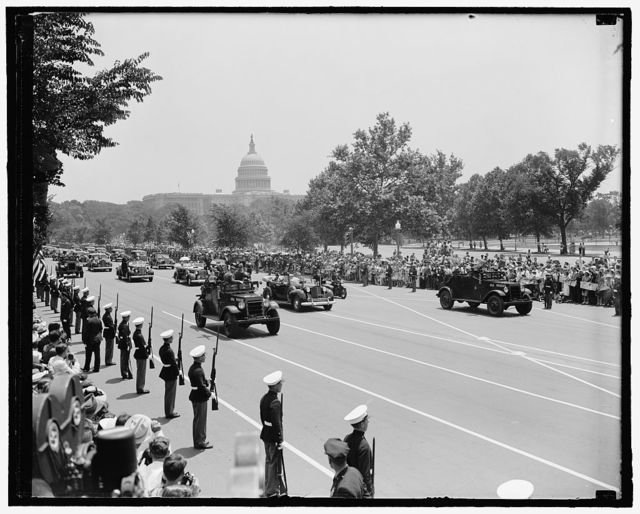 King & Queen [of Great Britain; motorcade, Capitol in background]