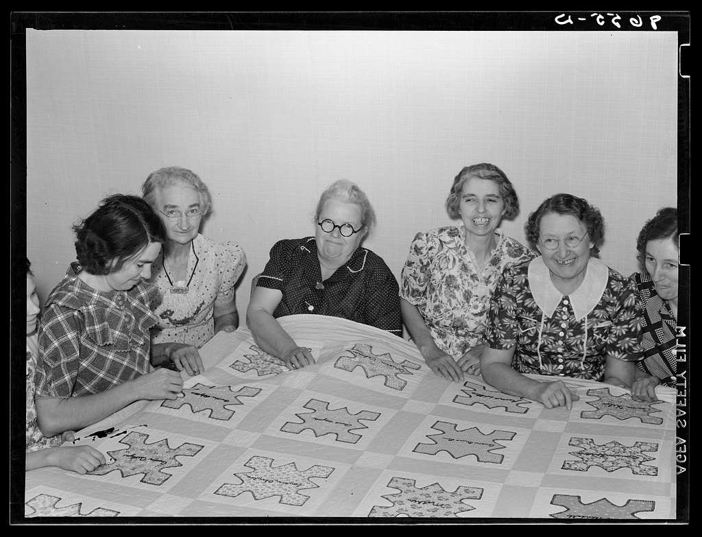 Ladies of the Helping Hand society working on quilt. Gage County, Nebraska
