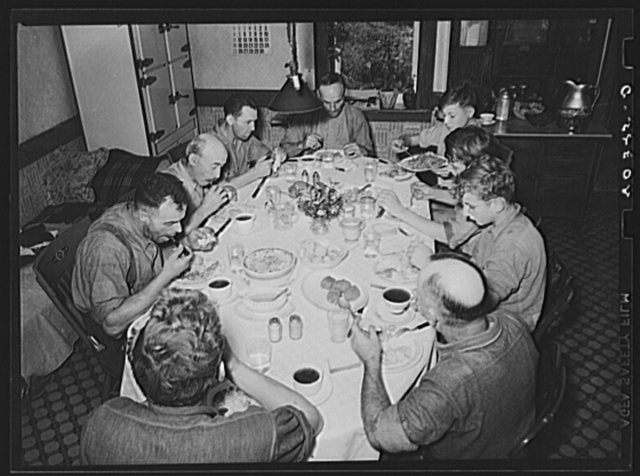 Lancaster County, Pennsylvania. Enos and Herbert Royer and the farm hands having dinner on the farm of Enos Royer. Three of the men are his hired hands, and the rest have come to help fill the silo