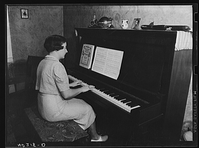Lancaster County, Pennsylvania. Martha Royer playing the piano on the Enos Royer farm