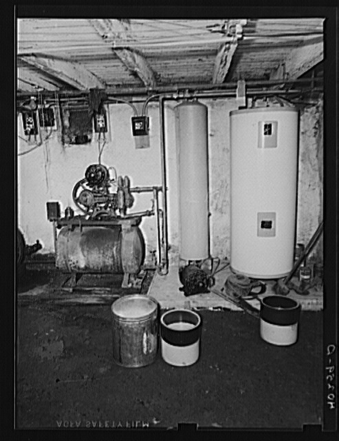 Lancaster County, Pennsylvania. The second pressure pump in the cellar of the house on the Enos Royer farm. The family's milk supply is stored here