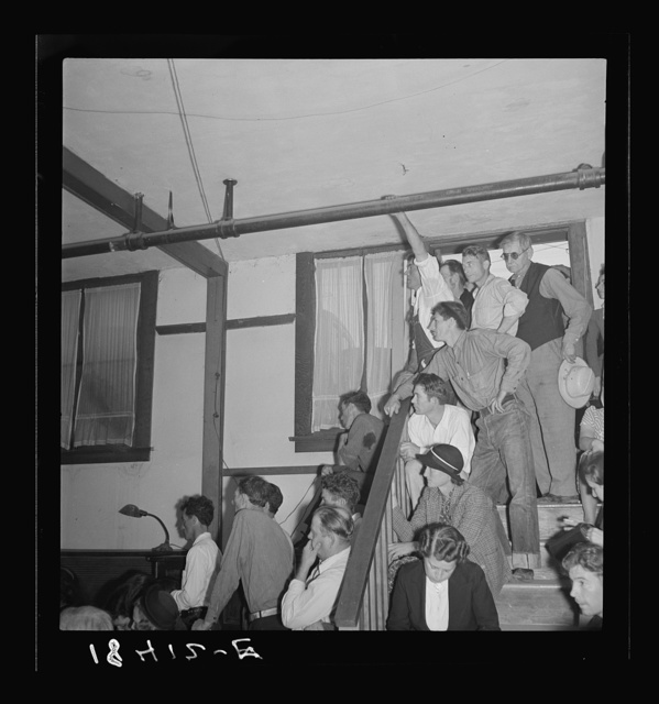 Listening to the speaker at the Conference to Aid Agricultural Organization during the cotton strike (Steinbeck Committee). Bakersfield, Kern County, California