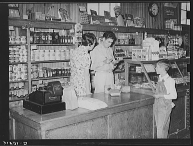 Making a sale, Lake Dick cooperative store. Lake Dick Project, Arkansas