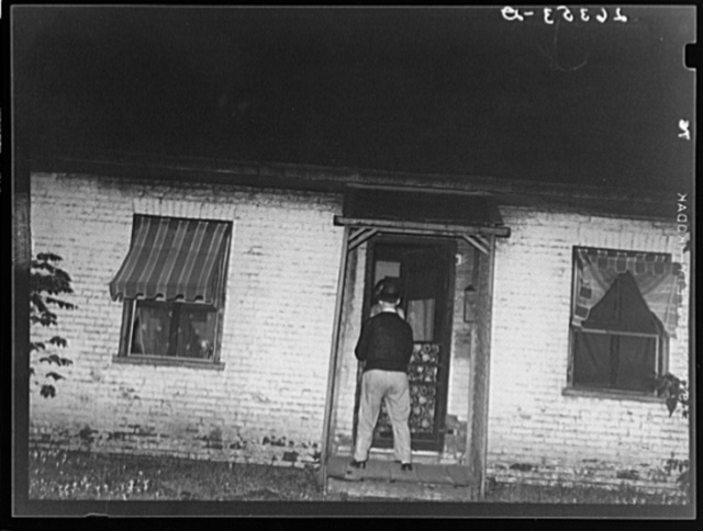 Man about to enter prostitute's house. Peoria, Illinois