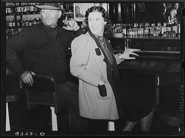 Man and girl at the bar. Saloon in North Platte, Nebraska