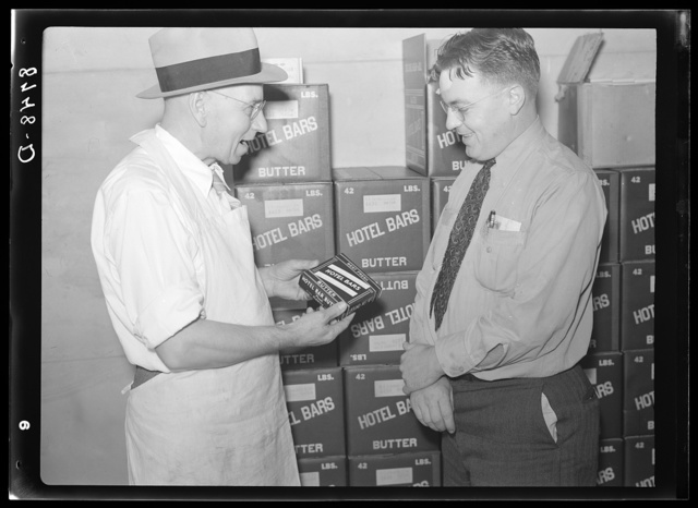 Manager of co-op creamery talking with Farm Security Administration county supervisor. Baldwin City, Kansas