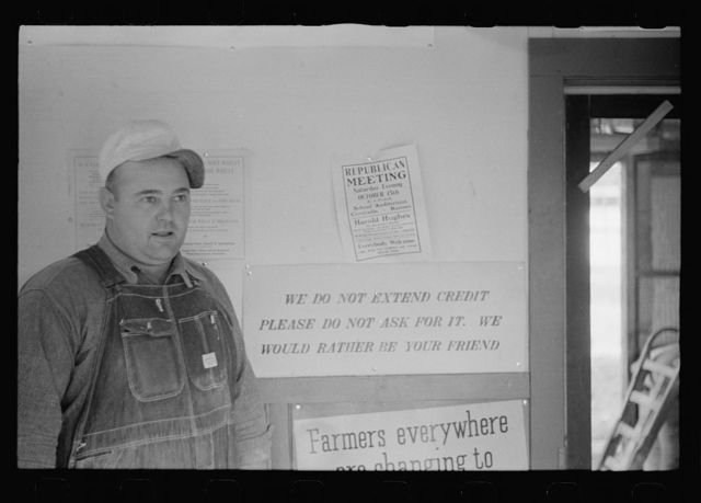 Manager of Farmer's Union Coop elevator in his office. This cooperative received a loan from the FSA (Farm Security Administration). Centralia, Kansas