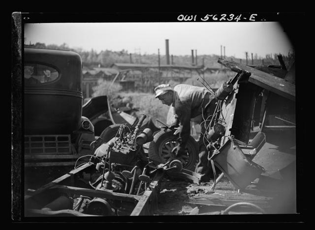 Manayunk, Pennsylvania. Workmen in an automobile junk yard on Ridge Avenue