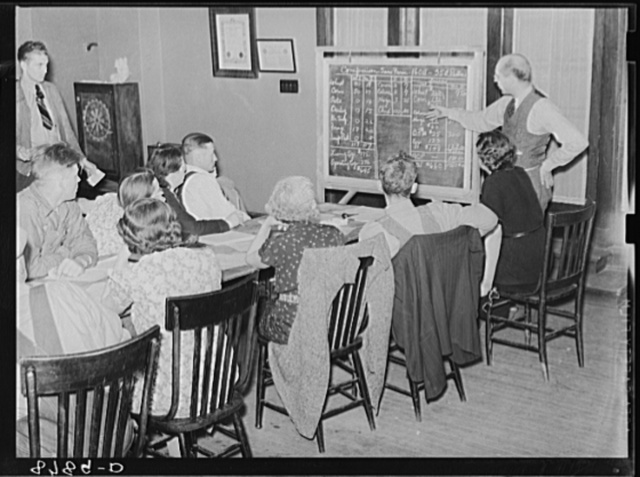 Meeting of Farm Security Administration rehabilitation clients who work out farm and home plans with help of county supervisor and home supervisor. York, Nebraska