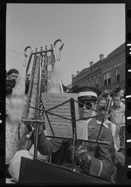 Member of Southwestern University band with instrument, National Rice Festival, Crowley, Louisiana